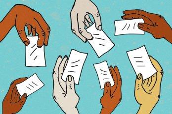 Hands holding ballots